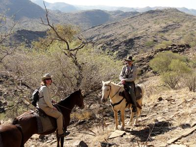 On horses in Khomas Hochland mountains, Namibia