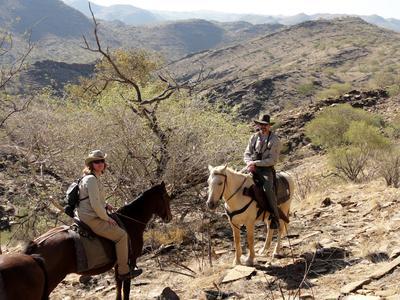 On horses in Khomas Hochland mountains, Namibia